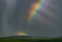 This rainbow appeared in a small thunderstorm just outside of Sheridan. I used a telephoto lens to get a close-up view as it changed by the second.