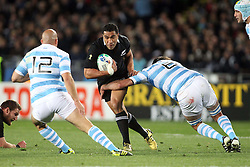 © Andrew Fosker / Seconds Left Images 2011 - New Zealand's Mils Muliaina with golden boots on his 100th test  tries to cut inside Argentina's Leonardo Senatore (R) & Argentina's Felipe Contepomi (Capt.) New Zealand All Blacks v Argentina - Rugby World Cup 2011 - Quarter Final - Eden Park - Auckland - New Zealand - 09/10/2011 -  All rights reserved..