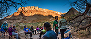 Sunset happy hour at Lava Canyon Camp at Colorado River Mile 66. Day 4 of 16 days boating 226 miles down the Colorado River in Grand Canyon National Park, Arizona, USA. Multiple overlapping photos were stitched to make this panorama. For this photo's licensing options, please inquire at PhotoSeek.com. .