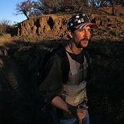 """Chris Simcox helped found the Minutemen, a group of anti illegal immigration advocates who spend time along the U.S.-Mexico border patrolling for undocumented migrants. Simcox helped launch the organization by issuing a """"Call to Arms"""" in the local Tombstone Tumbleweed publication he owned in Tombstone, Arizona. Please contact Todd Bigelow directly with your licensing requests. PLEASE CONTACT TODD BIGELOW DIRECTLY WITH YOUR LICENSING REQUEST. THANK YOU!"""