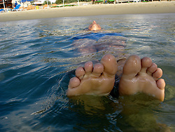man floating in the sea in Greece