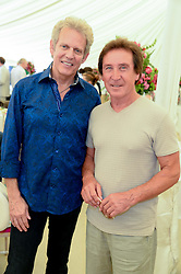 Left to right, DON FELDER the American musician and songwriter, best known for his work as lead guitarist for the Eagles and KENNEY JONES drummer for The Who at the Cartier 'Style et Luxe' part of the Goodwood Festival of Speed, Goodwood House, West Sussex on 14th July 2013.