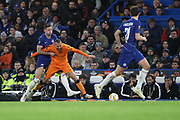 Gary Cahill of Chelsea (24) fouling Omar El Kaddouri of PAOK FC (7), yellow card during the Champions League group stage match between Chelsea and PAOK Salonica at Stamford Bridge, London, England on 29 November 2018.