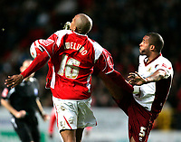 Photo: Tom Dulat/Sportsbeat Images.<br /> <br /> Charlton Athletic v Burnley. Coca Cola Championship. 01/12/2007.<br /> <br /> Clarke Carlisle of Burnley and Chris Iwelumo of Charlton Athletic with the ball.