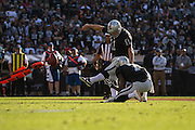 Oakland Raiders kicker Sebastian Janikowski (11) kicks the ball for an extra point against the Tennessee Titans at Oakland Coliseum in Oakland, Calif., on August 26, 2016. (Stan Olszewski/Special to S.F. Examiner)