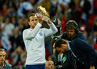 Football - 2018 / 2019 UEFA Nations League A - Group Four: England vs. Spain<br /> <br /> Harry Kane (England) shows off his Golden boot to the crowd at Wembley Stadium.<br /> <br /> COLORSPORT/DANIEL BEARHAM