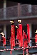 Close-up shot with view of red candles at the City God Temple, Zhujiajiao, Shanghai, China