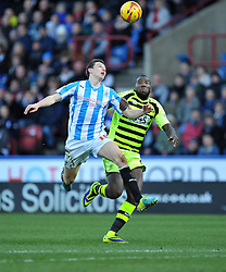 Huddersfield Town's Murray Wallace wins a high ball from Yeovil Town's Ishmael Miller - Photo mandatory by-line: Alex James/JMP - Tel: Mobile: 07966 386802 29/12/2013 - SPORT - FOOTBALL - John Smith's Stadium - Huddersfield - Huddersfield Town v Yeovil Town - Sky Bet Championship