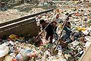 Youngsters sift through the garbage at the dump in Crematorio, Honduras looking for things they can sell, eat or wear. Honduras is considered the third poorest country in the Western Hemisphere (Haiti, Nicaragua). With over 50% of the population living below the poverty line and 28% unemployed, Hondurans frequently turn to illegal immigration as a solution to their desperate situation. The Department of Homeland Security has noted an 95% increase in illegal immigrants coming from Honduras between 2000 and 2009, the largest increase of any country.