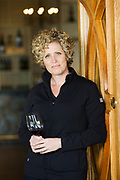 Holly Turner, wine maker at Three Rivers WInery holding a glass of wine.