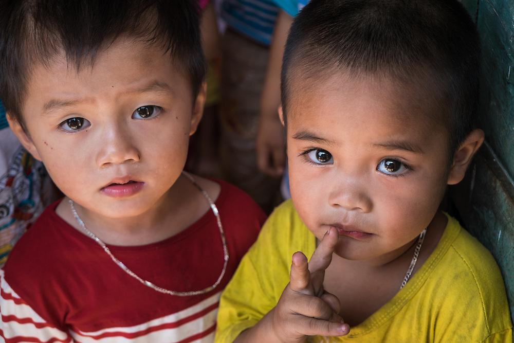 VIET HUNG, VIETNAM - CIRCA SEPTEMBER 2014:  Portrait of vietnamese kids from a kindergarden at the Viet Hung village  in Vietnam