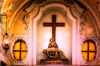 """""""Pietà in the church of Santa Sofia - Anacapri""""...<br /> <br /> Is located in the Piazza of Anacapri, the mountaintop above the island of Capri. It dates to 1595 when it replaced Chiesa di Santa Maria di Costantinopoli as the parish church.  One can view the ancient church contrasting with the more modern white façade. The sacristy and oratorio, were originally in the Chiesa di San Carlo. Architectural features include two bell towers and a baroque facade. The church was enlarged with two chapels and the nave was extended towards the square. The plan of the church is in the form of a Latin cross with a single nave, lateral chapels and a dome above the intersection of the nave and the transept. The belfry can be seen to the left of the facade with two clocks and three bells dedicated to Santa Sofia, Santa Maroa and Santa Elia. The highlight of my visit was the small and very crowded bus ride along the cliffs edge to Anacapri. I was standing closest to the door on the right side of the bus during the assent up the mountainside. All I could see was the rocky shore below and with every leaning left turn, prayed desperately I would make it to the top. Anacapri is a historic mountaintop town with commanding views of Capri and the sea below, as well as a concentration of Mediterranean colors, scents, and sounds. Town life here has remained authentic despite the island's tourism: tucked between the houses there are tiny, humble vegetable gardens surrounded by lush tropical plants. A walk around the center of Anacapri will take you past tiny Neapolitan tailor shops, artisan shoemakers, and Enoteca       ...all with the scent of the town's lemon groves that permeates the air. How the ancients managed to arrive at this secluded island and traverse their way to settlements atop is mind boggling.  However, contemplating the mysteries of civilization, one gets lost in the plush ambience. The pleasant aroma and commanding sea view demand that you stay for just a little while longe"""
