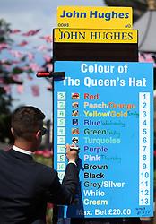 Stephen Hughes writes down the odds for the colour of Queen Elizabeth II's hat ahead of day five of Royal Ascot at Ascot Racecourse.