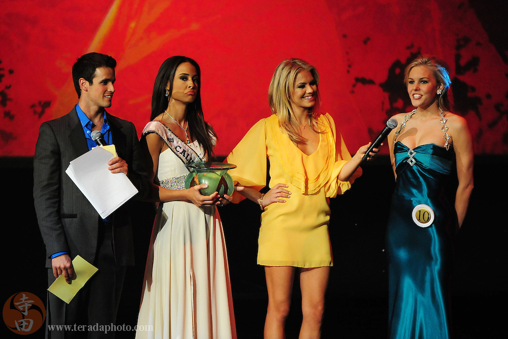 """November 22, 2009; Rancho Mirage, CA, USA; Miss Poway Teen USA Emma Baker (far right) answers her interview question as Miss California Teen USA 2009 Chelsea Gilligan (second from left) looks on during interview question final round of the Miss California Teen USA 2010 Pageant at """"The Show"""" at the Agua Caliente Resort & Spa. Mandatory Credit: Kyle Terada-Terada Photo"""