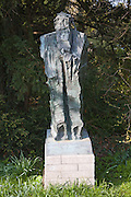 Sculpture of Confucious in the garden of Clare College, Cambridge university, England