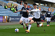 Millwall defender Danny McNamara(23)  and Rotherham United midfielder Ryan Giles (30) battles for possession during the EFL Sky Bet Championship match between Millwall and Rotherham United at The Den, London, England on 2 April 2021.