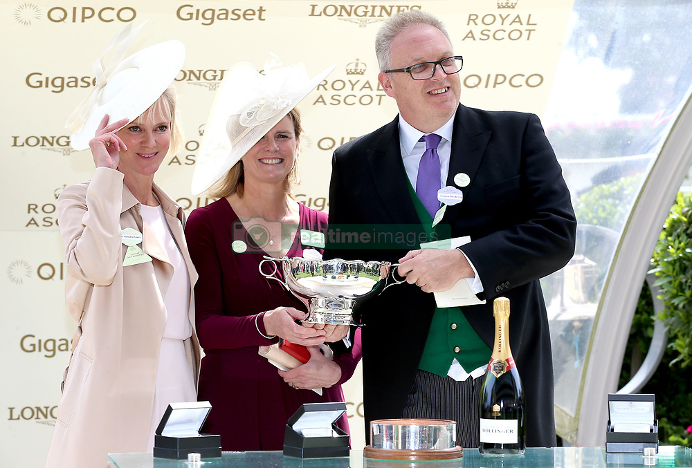 Presenter Hermione Borris (left) Owner Andrew Black (right) and wife Jane Black during the presentation for the Chesham Stakes during day five of Royal Ascot at Ascot Racecourse.