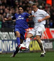 Photo: Paul Thomas.<br /> Bolton Wanderers v Everton. The Barclays Premiership. 09/04/2007.<br /> <br /> Mikael Arteta (L) of Everton battles with goal scorer Kevin Davies.