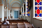 A man prays in The Church of Notre Dame des Anges, Pondicherry, India. Pondicherry now Puducherry is a Union Territory of India and was a French territory until 1954 legally on 16 August 1962. The French Quarter of the town retains a strong French influence in terms of architecture and culture.