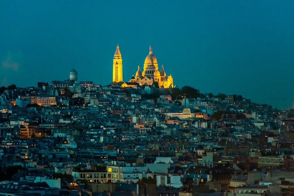 Sacre Coeur Basilica sits atop Montmatre, a large hill (butte) in northern Paris, France.