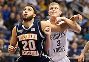 BYU guard Tyler Haws (3) and Northern Arizona forward Gaellan Bewernick (20) fight for position during the first half of the NCAA basketball game between the BYU Cougars and the Northern Arizona Lumberjacks at Marriott Arena, Thursday, Dec. 27, 2012.