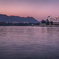 A long exposure enhances the already stunning colors of a pre-dawn sky. Taken at Lake Pichola, in Udaipur, India.