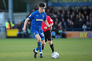 AFC Wimbledon midfielder Callum Reilly (33) dribbling during the EFL Sky Bet League 1 match between AFC Wimbledon and Fleetwood Town at the Cherry Red Records Stadium, Kingston, England on 8 February 2020.