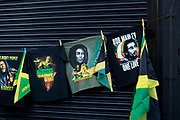 Hackney Carnival on 8th September 2019 in London, United Kingdom. Bob Marley t-shirts and Jamaican flags.