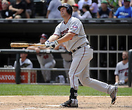 CHICAGO - JULY 10:  Michael Cuddyer #5 of the Minnesota Twins bats against the Chicago White Sox on July 10, 2011 at U.S. Cellular Field in Chicago, Illinois.  The Twins defeated the White Sox 6-3.  (Photo by Ron Vesely)  Subject: Michael Cuddyer