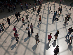 Crowds of tourists visiting The Louvre museum in Paris France