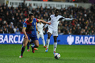 Swansea city's Nathan Dyer ® is challenged by Scott Dann. Barclays Premier league, Swansea city v Crystal Palace match at the Liberty Stadium in Swansea, South Wales on Sunday 2nd March 2014.<br /> pic by Andrew Orchard, Andrew Orchard sports photography.