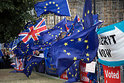 Anti Brexit protesters with messages to Stop Brexit, Stop the Coup and Pro Democracy in Westminster on the day that Parliament reconvenes after summer recess to debate and vote on a bill to prevent the UK leaving the EU without a deal at the end of October, on 3rd September 2019 in London, England, United Kingdom. Today Prime Minister Boris Johnson will face a showdown after he threatened rebel Conservative MPs who vote against him with deselection, and vowed to aim for a snap general election if MPs succeed in a bid to take control of parliamentary proceedings to allow them to discuss legislation to block a no-deal Brexit.
