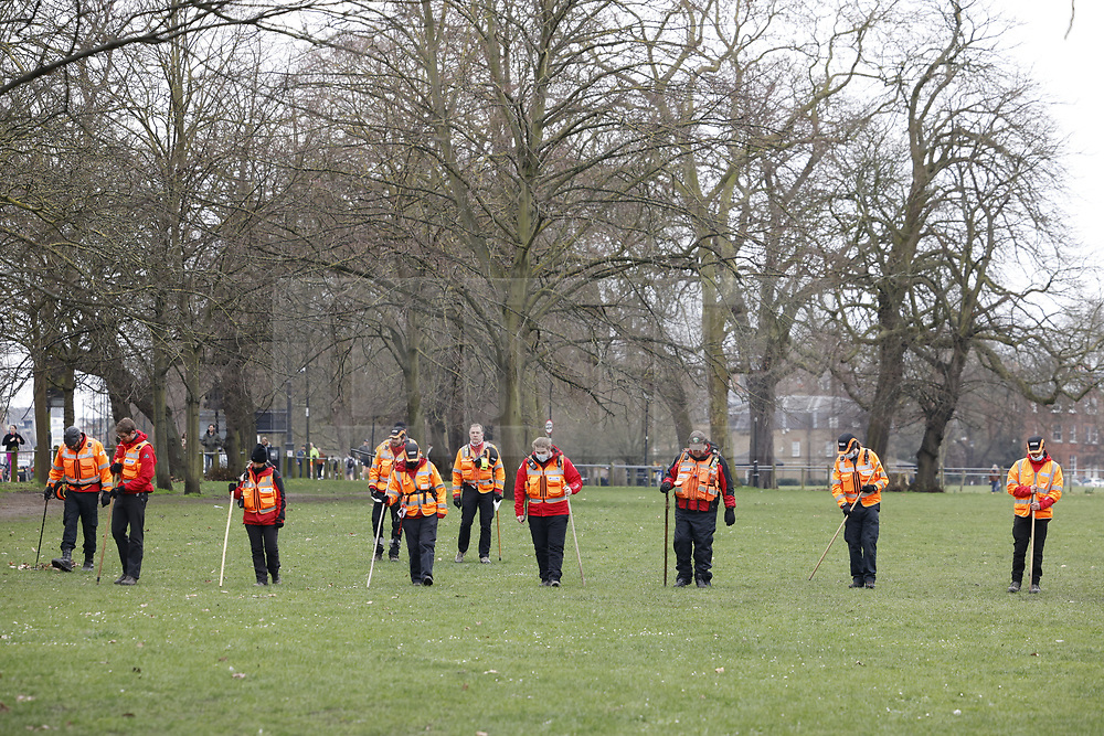 © Licensed to London News Pictures. 07/03/2021. London, UK. Police and members of London Search and Rescue teams search Clapham Common for missing 33 year old woman Sarah Everard. Police are concerned for the safety of Ms Everard who has been missing for four days after leaving a friend's house in Leathwaite Road, Clapham, London. She is thought to have walked across Clapham Common, and was due to arrive home in Brixton 50 minutes later. Photo credit: Peter Macdiarmid/LNP