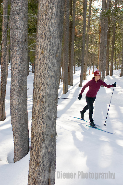 A young woman cross country skiing in Jackson Hole, Wyoming.