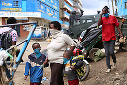 May 11, 2020, Nairobi, Kenya: Residents walk past a police armed vehicle in Eastleigh during the protest..Eastleigh Residents took to the street to protest restriction of movement in the area due to the widespread case of Covid-19 within the residential area and appealed to the government to provide them with relief food. Kenya has confirmed 672 cases of Covid-19 and 32 deaths. (Credit Image: © Billy Mutai/SOPA Images via ZUMA Wire)