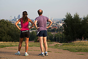 "Runners on top of Parliament Hill with an amazing view towards the City fof London. Hampstead Heath (locally known as ""the Heath"") is a large, ancient London park, covering 320 hectares (790 acres). This grassy public space is one of the highest points in London, running from Hampstead to Highgate. The Heath is rambling and hilly, embracing ponds, recent and ancient woodlands."