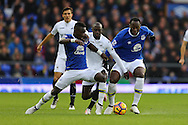 Modou Barrow of Swansea City (c) is tackled by Idrissa Gueye (l) and Romelu Lukaku of Everton. Premier league match, Everton v Swansea city at Goodison Park in Liverpool, Merseyside on Saturday 19th November 2016.<br /> pic by Chris Stading, Andrew Orchard sports photography.