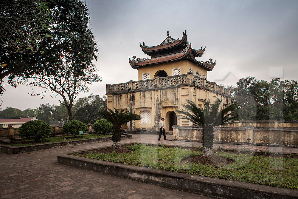 Citadel of Hanoi, also called Imperial Citadel of Thang Long. Antique Vietnamese architectural style. Cloudy sky in background. Hanoi, Vietnam, Asia.