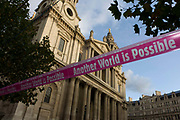 An anti-capitalist message declaring that another world is possible on stretched tape below the pillars and columns of the Sir Christopher Wren-designed St Paul's Cathedral on the 11th day of the Occupy London protest camp in its churchyard, London 26/11/11. Forced to close for the first time since the 2nd world war, due to health and safety concerns, preventing services City lawyers are using medieval pedestrian bylaws to gain a court injunction to evict the activists who set up tents and shelters.