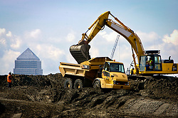 IBC MPC. Digger and truck moving soil, with Canary Wharf in the background. Picture by David Poultney.