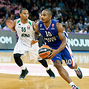 Anadolu Efes's Dontaye Draper (R) and Unics Kazan's Curtis Jerrells (L) during their Turkish Airlines Euroleague Basketball Group A Round 1 match Anadolu Efes between Unics Kazan at Abdi ipekci arena in Istanbul, Turkey, Thursday, October 16, 2014. Photo by Aykut AKICI/TURKPIX