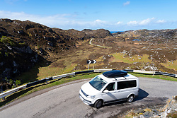 Single track road and camper van on the North Coast 500 scenic driving route in Assynt northern Scotland, UK