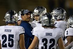 Nevada head coach Jay Norvell (in blue) confers with his players during a time out in the fourth quarter of an NCAA college football game against California, Saturday, Sept. 4, 2021, in Berkeley, Calif. (AP Photo/D. Ross Cameron)