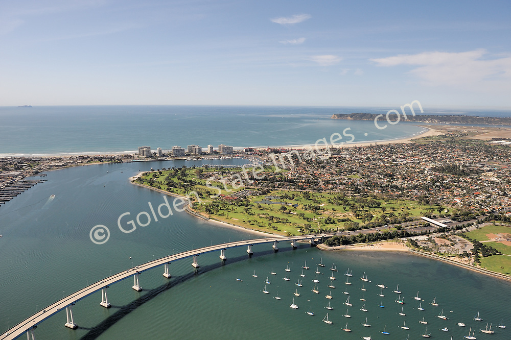 Aerial photo shot from Downtown San Diego, with Point Loma in the distance.