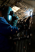 A worker welding metal plates