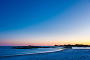 Fading light in a winter sky over Gooseberry beach, Newport, RI with Seafair mansion in the distance