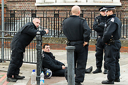 © Licensed to London News Pictures . 07/08/2011 . London , UK . Police on Tottenham High Street . Overnight rioting and looting in Tottenham , following a protest against the police shooting of Mark Duggan . Photo credit : Joel Goodman/LNP