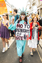 © Licensed to London News Pictures . 13/07/2018. London, UK. A woman dressed as the Statue of Liberty . Demonstrators march from Portland Place to Trafalgar Square in protest against US President Donald Trump's UK visit . Photo credit: Joel Goodman/LNP