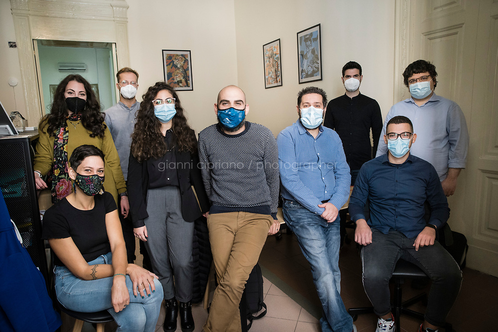 NAPLES, ITALY - 20 OCTOBER 2020: David Cézon (41, center), COO of I'm OK - a startup that has created a virtual assistant for the management of commercial activities, such as restaurants, stores and offices - poses for a portrait a group portrait with his team in their office in Naples, Italy, on October 20th 2020.<br /> <br /> In the past few years Naples been fostering a growing community of tech start-ups and app creators. What has really changed the game for Naples' tech scene is Apple's recent arrival in the city. In 2015, Apple opened its Developer Acamdy in Naples, in conjunction with University of Naples Federico II, where students spend a year training to be developers, coders, app creators and start-up entrepreneurs. <br /> <br /> And where Apple goes, others follow. In 2018, networking giant Cisco opened its own networking academy in Naples.<br /> <br /> The hope is it will change not just Naples' reputation, but also its fortunes and so reverse a brain drain that's seen many of the city's young graduates leave to find jobs in the more prosperous north of Italy, or even abroad. Naples, and its region, Campania, is part of the Mezzogiorno (southern Italy and Sicily) which lags behind the rest of the country in terms of economic growth. Here the youth jobless rate was above 50% in 2019, among the highest unemployment rate in Europe.