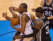 June 2, 2012; Oklahoma City, OK, USA; Oklahoma City Thunder forward Kevin Durant (35) tries to keep control of the ball under pressure from San Antonio Spurs forward Kawhi Leonard and forwars Stephen Jackson (3) during a playoff game  at Chesapeake Energy Arena.  Thunder defeated the Spurs 109-103 Mandatory Credit: Beth Hall-US PRESSWIRE